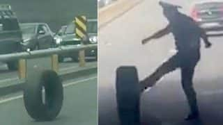 This Kazakhstan Police Officer Trying to Stop a Rolling Tyre is Quite Funny (Watch Video)