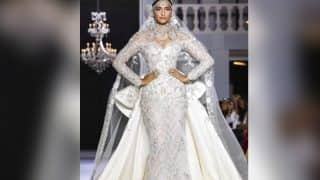 Sonam Kapoor dazzles as Ralph & Russo's showstopper in a white embellished bridal gown