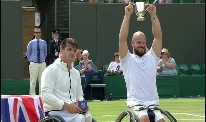Stefan Olsson with the Wimbledon Wheelchair trophy.