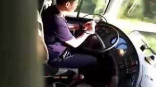 Man Peels Apples While Driving Bus on the Highway in China; Gets Fired! Video Goes Viral