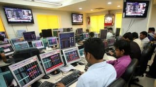 Markets Recover Slightly But End in Red; Sensex Closes 309 Points Down at 34,757, Nifty 94 Points Low at 10,666