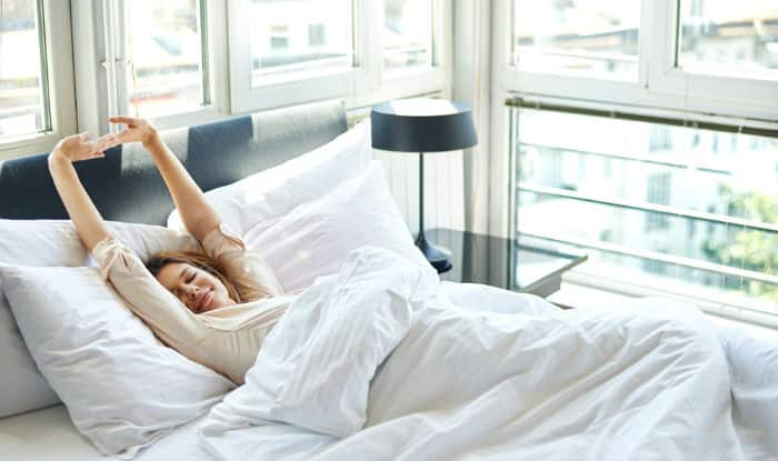 5 Stretches You Should Do Before Getting out of Bed | India.com