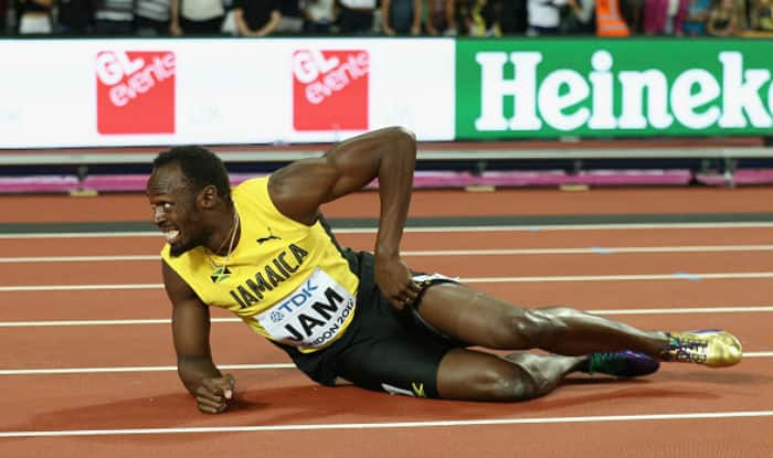 Usain Bolt falls to the track in the Men's 4x100 Relay final during at IAAF World Athletics Championships | Getty Images