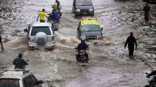 High Tide, Heavy Rains Flood Mumbai, Local Trains Suspended, Chaos on Roads