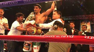 Vijender Singh Beats Zulipikaer Maimaitiali to Win Unified WTO Title