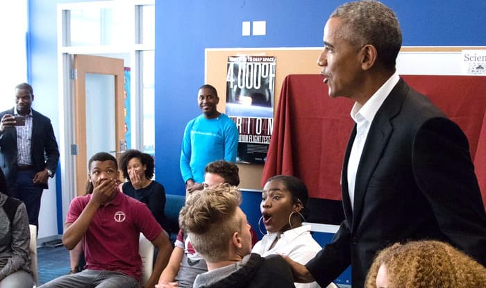 Barack Obama surprises students with visit to DC school