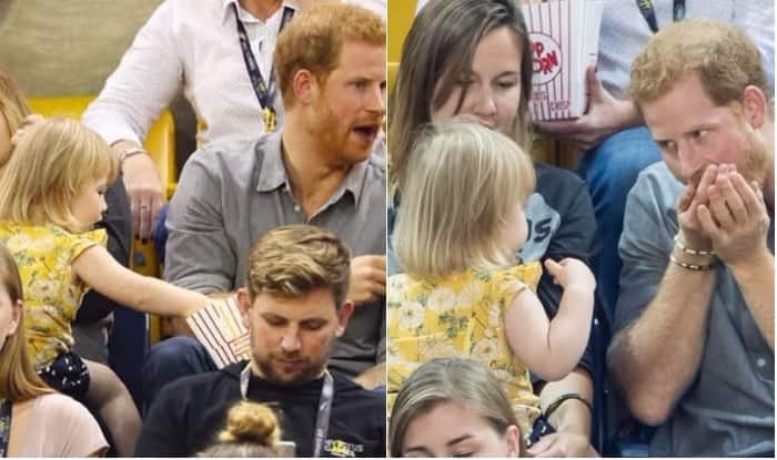 Toddler takes popcorn from Prince Harry