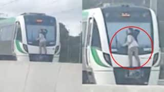 Man Clings to Fast-Moving Train in Australia, Arrested
