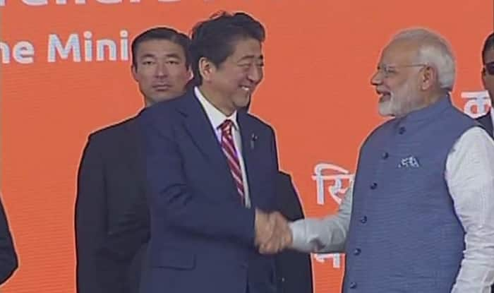 Shinzo Abe, Modi shake hands after laying foundation for India's first bullet train (ANI)