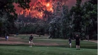 Eagle Creek Fire: Despite Wildfire Nearby Golfers Continue Playing, Pictures go Viral