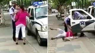 Shocking Video Of Police Officer Slamming Woman And Child In China Goes Viral