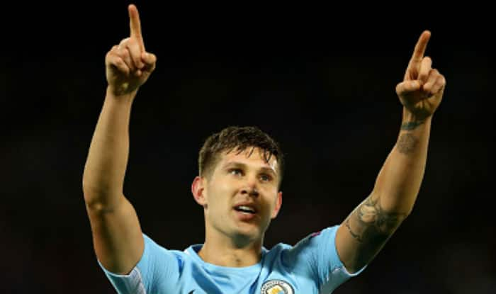 John Stones celebrates scoring his sides fourth goal during the UEFA Champions League group F match between Feyenoord and Manchester City | Getty Images
