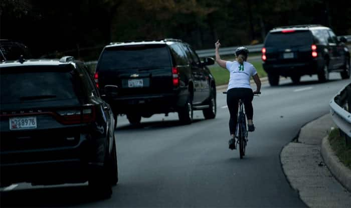 Cyclist gives Trump the finger as she rides past his motorcade