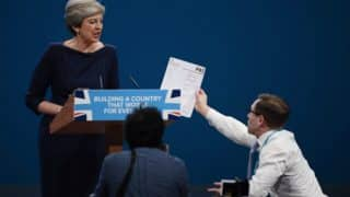 British PM Theresa May Handed 'Pink Slip' by Prankster Lee Nelson During Speech