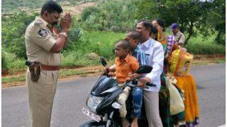 बाइक पर 5 लोगों को देखकर पुलिसकर्मी ने जोड़ लिए हाथ, फोटो वायरल