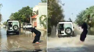 Woman Surfboards Through Jeddah