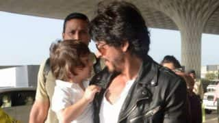 Little Abram Trying To Catch Up With Shah Rukh Khan With His Sweet Talk While Walking Is Too Cute To Be Missed - Watch Videos