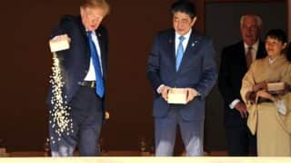 Donald Trump Dumps Box Of Fish Food Into Pond At Tokyo's Akasaka Palace, Twitterati Furious