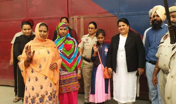 Two women, 10-year-old girl released from Indian jail reach home