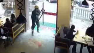 Chinese Delivery Man Walks Through A Glass Door and Yet Escapes Injury in This Viral Video