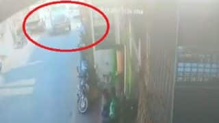 Watch Video: Man Falls in Front of Truck After His Bike Slips in Uttarakhand, Survives