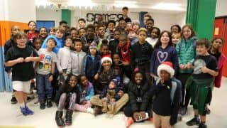 Barack Obama Dresses as Santa And Surprises Children at DC Boys & Girls Club During Christmas Celebrations