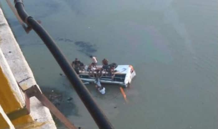 Bus falls into river in India, killing at least 33
