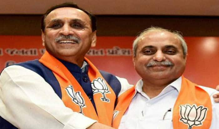 After gritty battle over portfolio, Gujarat Deputy CM Nitin Patel emerges victorious class=