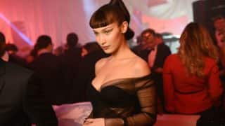 Bella Hadid's Liquid-Gold Eyeshadow Is a Proof That Glitter Trend Isn't Over Yet