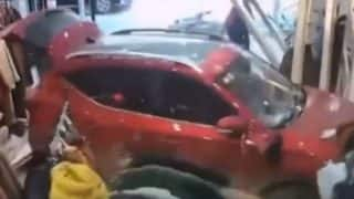 Man Driving Without License Smashes Into Clothes Store In China (Video)