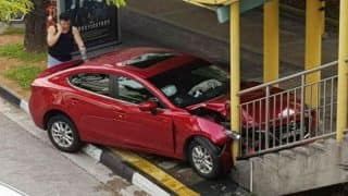 Singapore Woman Crashes Car Into Bridge After She Spots a Cockroach in Her Red Mazda