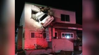 Car Hits Divider, Gets Stuck in 2nd floor of Building in California
