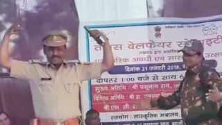 Photo of Lucknow Police Officer Dancing on Stage, Brandishing Service Revolver Fake