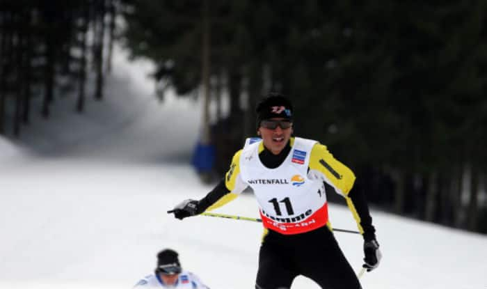 Cologna wins third successive Winter Olympic 15km cross country title