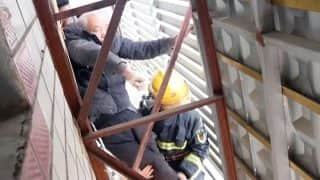 Elderly Man Falls From Balcony, Gets Stuck in Advertising Hoarding, Watch Thrilling Rescue