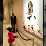This Little Girl's Photo of Looking up to Michelle Obama's Portrait is Going Viral for Providing Inspiration