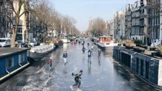 Pictures and Videos of People Ice Skating on the Canals in Amsterdam is Going Viral