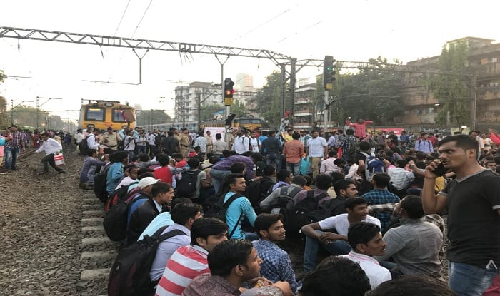 Lakhs face trouble in Mumbai, as students demanding job block railway track
