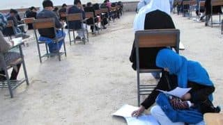Afghan Woman Breastfeeds Her Baby While Taking Exam, Inspiring Photo Is Going Viral