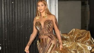 Beyonce Dons A Falguni and Shane Peacock Designed Golden Embellished Gown With A Dramatic Train And We're In Awe Of Her