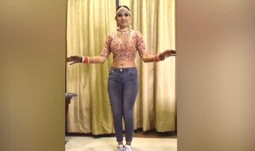 Indian bride dancing in 'choli', 'jeans' and 'chooda' is a sheer delight