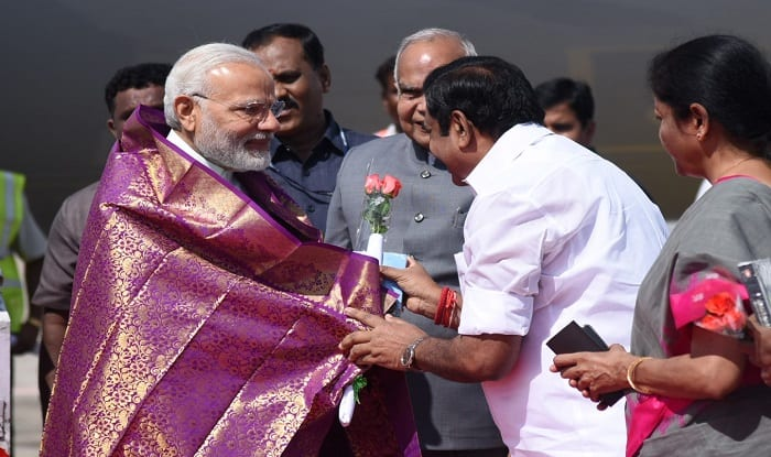 Prime Minister Narendra Modi being welcomed by the Governor of Tamil Nadu, Banwarilal Purohit and the Chief Minister of Tamil Nadu Edappadi K. Palaniswami, on his arrival, at Chennai.