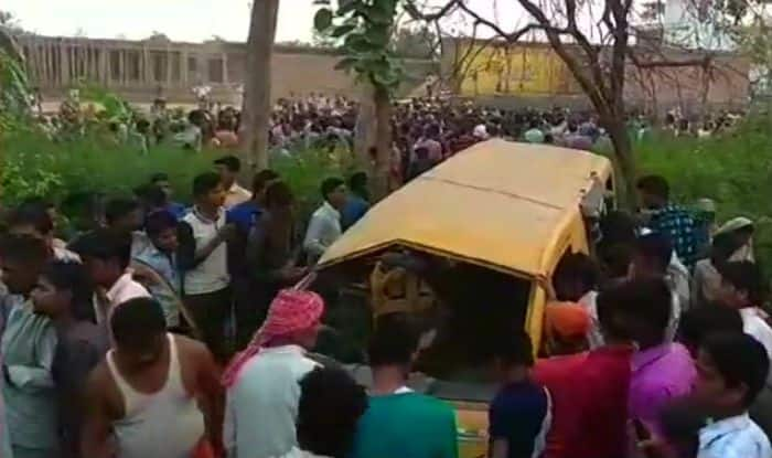 India bus crash: Thirteen children die as school bus hit by train