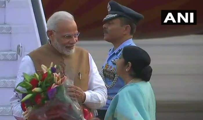 Prime Minister Narendra Modi being received by External Affairs Minister Sushma Swaraj in Delhi on Saturday