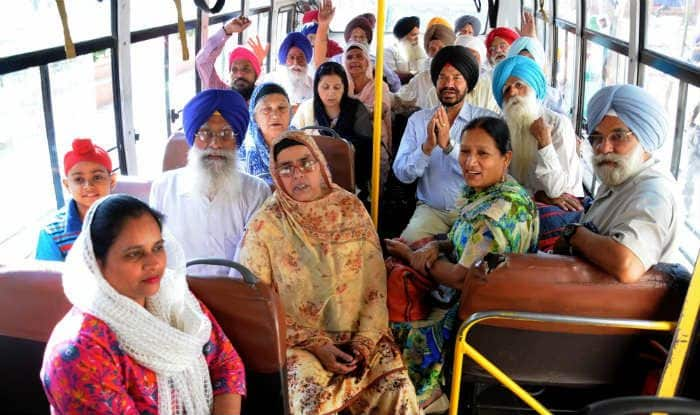Sikh pilgrims return home after celebrating Baisakhi in Pakistan