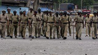 अनोखी पहल: भीड़ की हिंसा के विरोध में पुलिसकर्मियों ने निकाली रैली