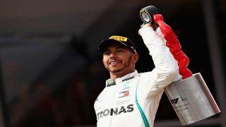 Lewis Hamilton Creates 'Magic' to Take Pole Position in Singapore