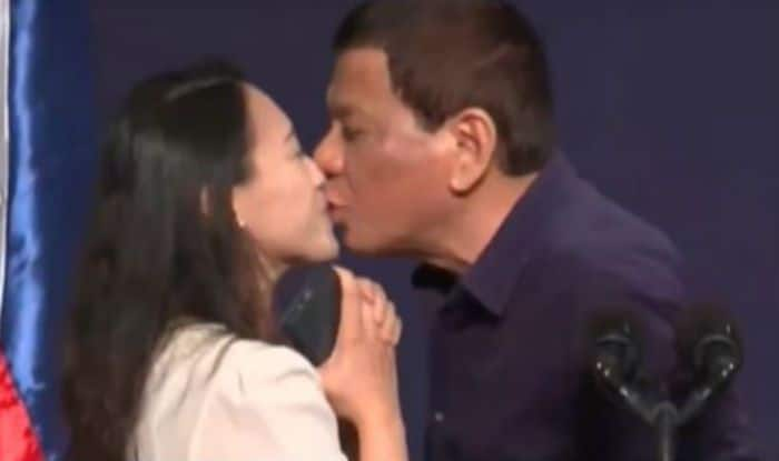 Philippines' Duterte stirs controversy by kissing woman on lips