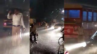 Mumbai Cop Braves Torrential Downpour to Ease Traffic; Video Goes Viral