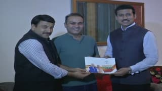 Virender Sehwag Meets Sports Minister Rajyavardhan Singh Rathore under 'Sampark for Samarthan' campaign